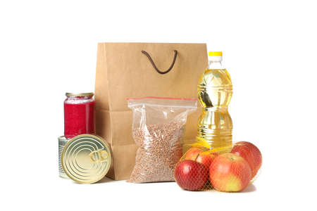 Paper bag and food isolated on white background. Food donations, delivery