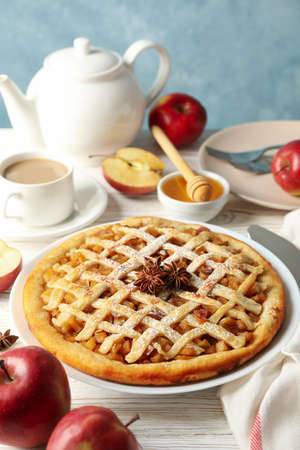 Composition with apple pie and ingredients on wooden background. Homemade food