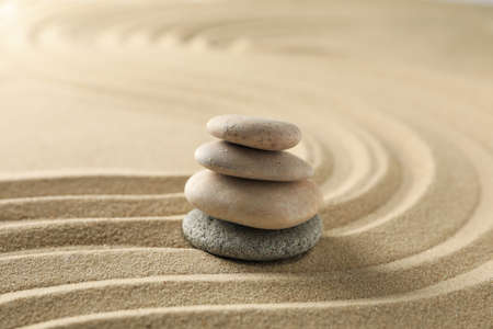 Stones on the sand with patterns. Zen concept Banque d'images