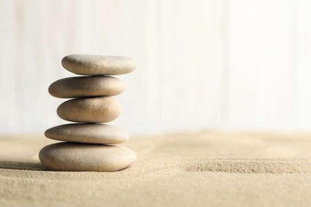 Stones on the sand background. Zen concept Banque d'images