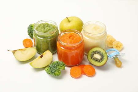 Composition with baby food on white background. Vegetable puree