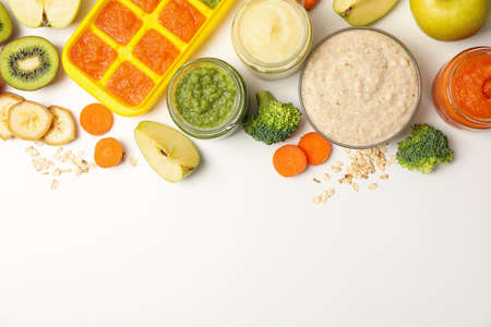 Composition with baby food on white background, top view