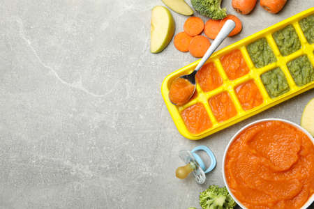 Composition with baby food on gray background, top view