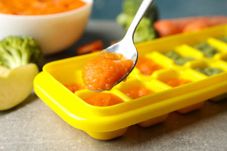 Composition with baby food on gray background, close up