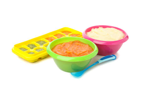 Bowls with vegetable puree on white background. Baby food