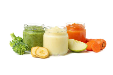 Glass jars with healthy baby food isolated on white background Фото со стока