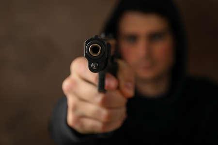 Man hold pistol. Selective focus. Robber. Violence Standard-Bild