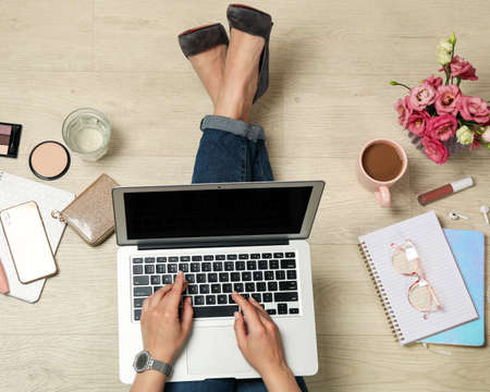 Girl works at a laptop, top view. Blogger concept Imagens