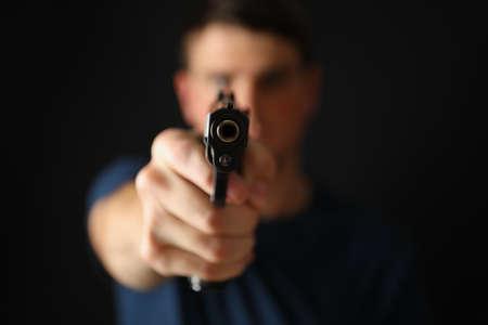Man hold pistol. Selective focus. Self defense weapon