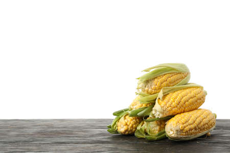 Corn on wooden table isolated on white background