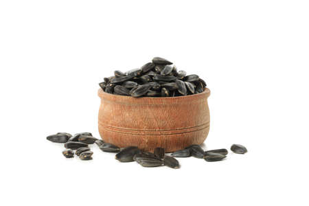 Bowl of sunflower seeds isolated on white background