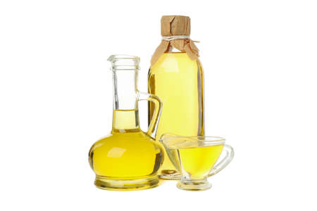 Glass jars with sunflower oil isolated on white background