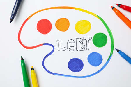 Felt-tip pens and LGBT drawing on white background