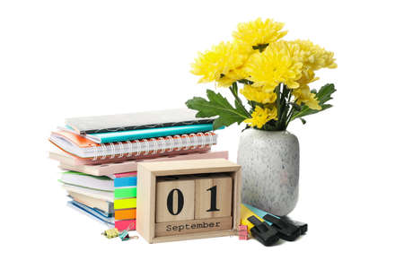 1 september wooden calendar and school supplies isolated on white background