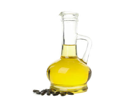 Glass jar of oil and seeds isolated on white background