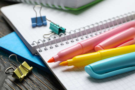 School supplies on wooden background, close up