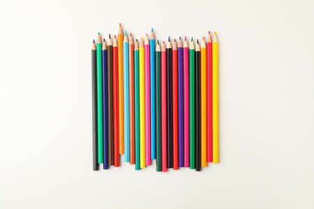 Colorful pencils on white background, top view