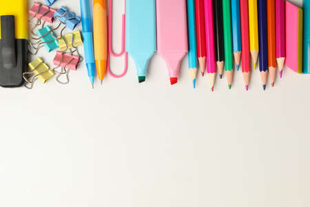 Frame of school supplies on white background, space for text