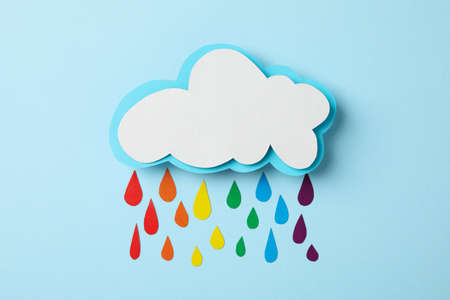 Cloud and drops in LGBT color on blue background