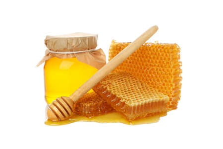 Glass jar of honey, dipper and honeycomb isolated on white background 版權商用圖片