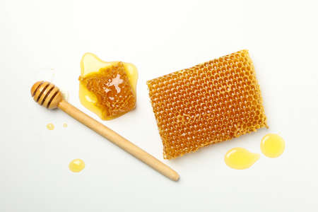 Honeycombs and dipper on white background, top view 版權商用圖片