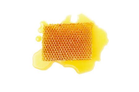 Fresh honeycomb piece isolated on white background