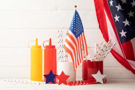 Composition with american flag, bottles for sauce and color stars on wooden background 版權商用圖片