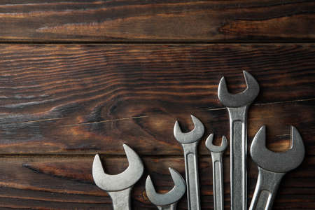Mechanic wrenches on wooden background, space for text 版權商用圖片