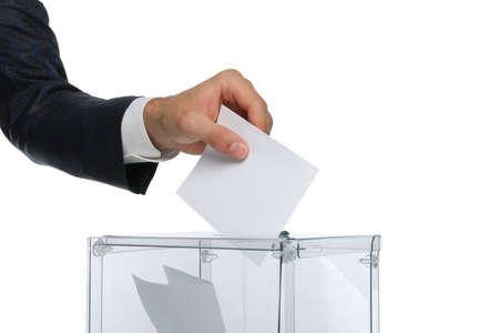 Man putting ballot into voting box, isolated on white background 版權商用圖片