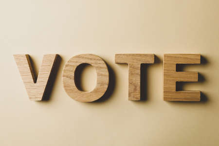 Word Vote made of wooden letters on beige background 版權商用圖片