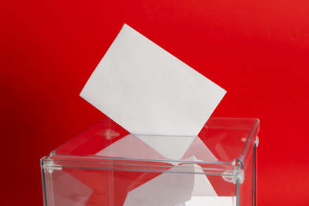 Voting box with bulletins on red background, space for text 版權商用圖片