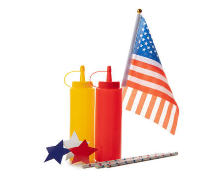 American flag, straws, stars and bottles for sauce isolated on white background