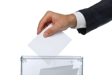 Man putting ballot into voting box, isolated on white background Archivio Fotografico