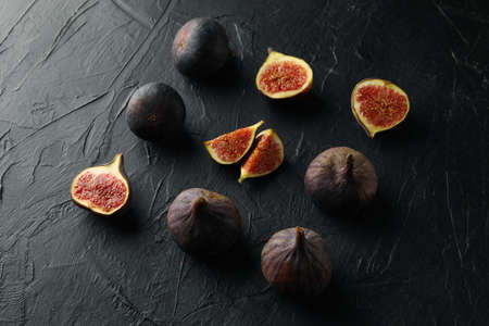 Flat lay with fig fruits on black background