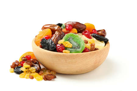 Bowl with dried fruits isolated on white background Archivio Fotografico