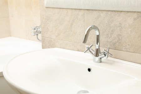 Sink in modern comfortable bathroom in light beige color Stock Photo