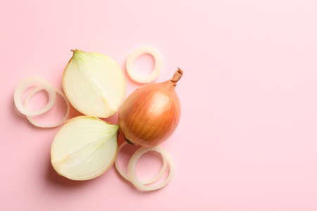 Fresh onion on pink background, top view