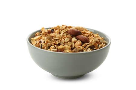 Bowl with tasty granola isolated on white background 免版税图像
