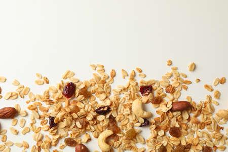 Tasty granola on white background, top view