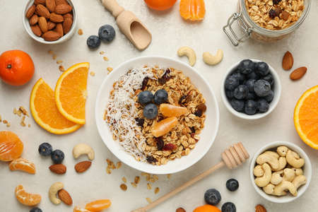 Concept of tasty breakfast with granola on white background