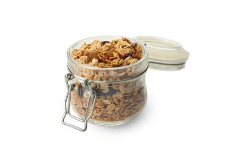 Jar with granola isolated on white background