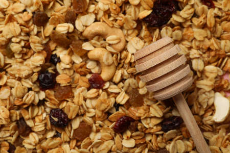 Granola with nuts and raisins, and dipper on whole background 免版税图像