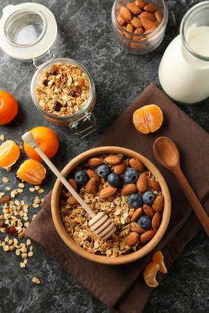 Concept of tasty breakfast with granola on black smokey background
