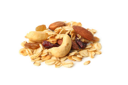Granola with nuts and raisins isolated on white background