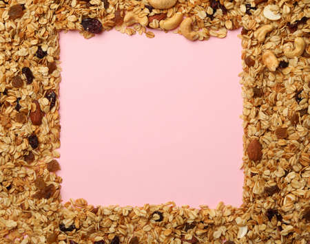 Tasty granola on pink background, space for text