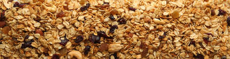 Granola with nuts and raisins on white background 免版税图像