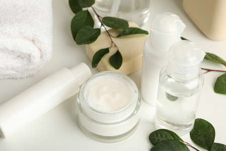Spa cosmetic products on white table, close up