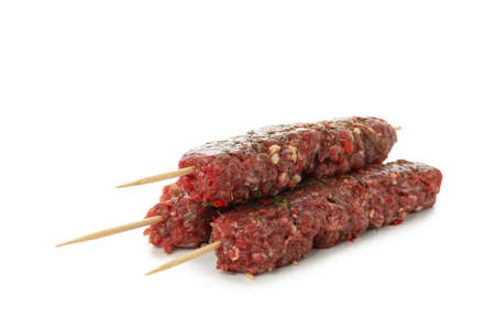Skewers with raw minced meat or lula kebab isolated on white background