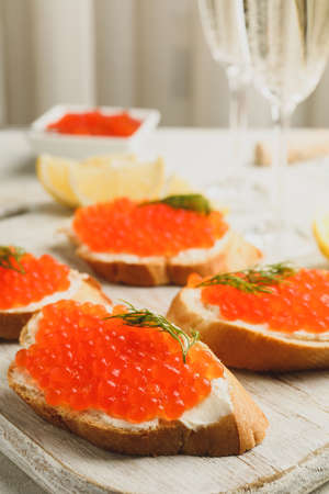 Concept of delicious eat with sandwiches with red caviar