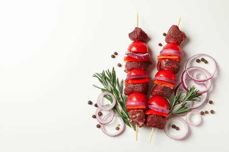 Raw shish kebab, herb and spices on white background Banco de Imagens